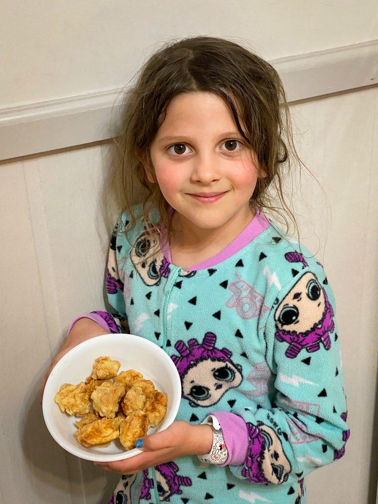 Emma with the popcorn fish