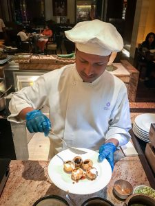 A chef preparing me pani puri