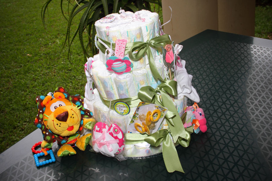 Baby shower cake made out of nappies with gifts attached