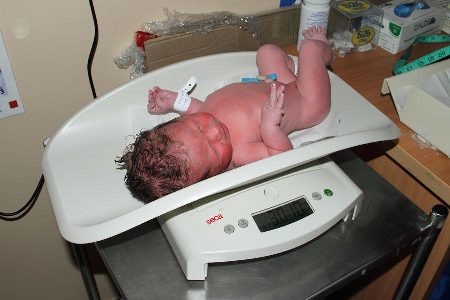 Emma Prior being weighed after birth