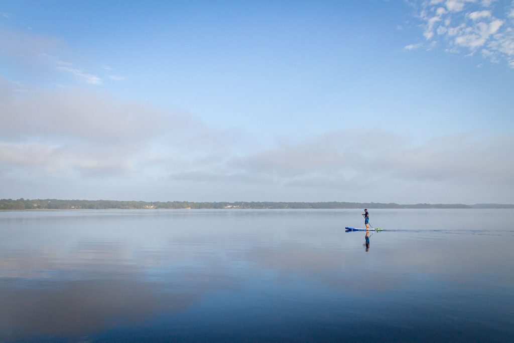 A standup paddle-boarder on Lake Munmorah